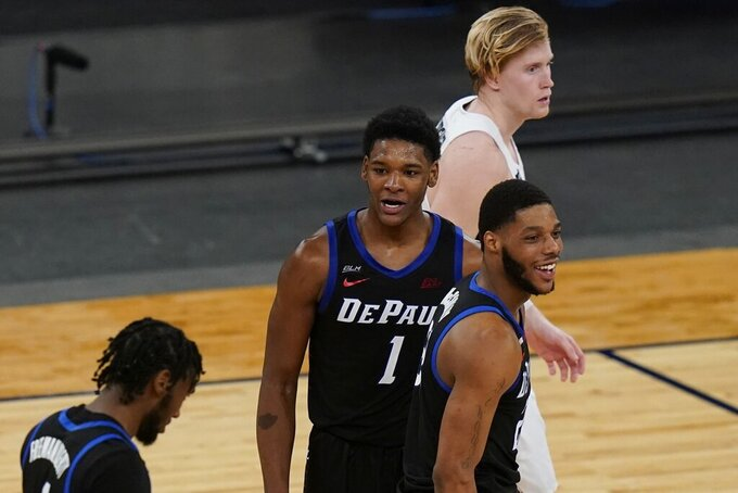 Providence's Noah Horchler, above, reacts as DePaul's Courvoisier McCauley, right, and Charlie Moore (11) celebrates toward the end of the second half of an NCAA college basketball game in the Big East conference tournament Wednesday, March 10, 2021, in New York. DePaul won 70-62. (AP Photo/Frank Franklin II)