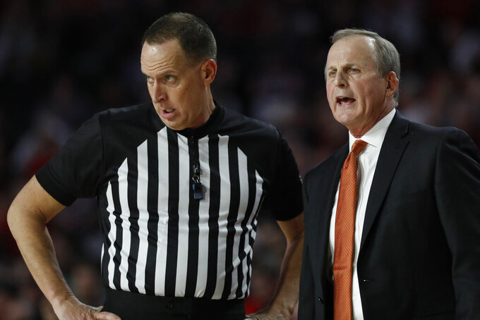 Tennessee coach Rick Barnes speaks with an official during the first half of the team's NCAA college basketball game against Georgia on Wednesday, Jan. 15, 2020, in Athens, Ga. (Joshua L. Jones/Athens Banner-Herald via AP)