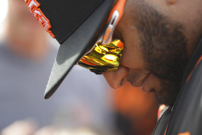 San Francisco Giants' Pablo Sandoval gives autographs to fans before a spring training baseball game against the Arizona Diamondbacks, Monday, March 2, 2020, in Scottsdale, Ariz.(AP Photo/Darron Cummings)
