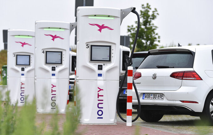 File---Picture taken July 19, 2019 shows the commissioning of an Ionity E super fast charging park,  with VW e-Golf  standing at the charging stations in Altenburg, Germany. (Martin Schutt/dpa via AP)