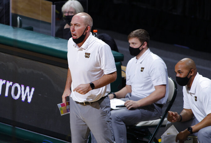 Western Michigan coach Clayton Bates, left, yells instructions during the first half of an NCAA college basketball game against Michigan State, Sunday, Dec. 6, 2020, in East Lansing, Mich. (AP Photo/Al Goldis)