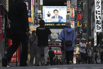 A public tv screen shows Japanese Prime Minister Shinzo Abe speaking at a press conference Monday, May 25, 2020, in Tokyo. Abe announced the lift of a coronavirus state of emergency from Tokyo and four other remaining prefectures. (AP Photo/Eugene Hoshiko)