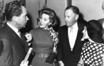 FILE - In this Sept. 26, 1962 file photo, Richard M. Nixon, Republican candidate for governor of California, chats actress Rhonda Fleming, actor George Murphy and actress- singer Jane Powell in Hollywood, Calif. Actress Rhonda Fleming, the fiery redhead who appeared with Burt Lancaster, Kirk Douglas, Charlton Heston, Ronald Reagan and other film stars of the 1940s and 1950s, has died, Wednesday, Oct. 14, 2020. She was 97. (AP Photo/File)