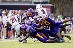 South Carolina's Juju McDowell (21) is stopped by East Carolina's D.J. Ford (9), Bruce Bivens (5), Warren Saba (17) during the second half of an NCAA college football game in Greenville, N.C., Saturday, Sept. 11, 2021. (AP Photo/Karl B DeBlaker)