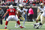 Wake Forest running back Matt Colburn (22) runs through an opening in the line during the first half of an NCAA college football game against Louisville, Saturday, Oct. 27, 2018, in Louisville, Ky. Wake Forest won 56-35. (AP Photo/Timothy D. Easley)