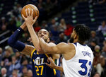 Utah Jazz center Rudy Gobert (27) is fouled by Minnesota Timberwolves center Karl-Anthony Towns (32) in the first quarter of an NBA basketball game Wednesday, Nov. 20, 2019 in Minneapolis. (AP Photo/Andy Clayton- King)