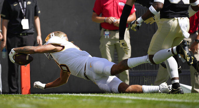Minnesota running back Ky Thomas dives into the end zone for a touchdown against Colorado in the second half of an NCAA college football game Saturday, Sept. 18, 2021, in Boulder, Colo. (AP Photo/David Zalubowski)