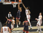 Washington State center Efe Abogidi (0) blocks a shot by Arizona guard Jemarl Baker Jr. (3) in the first half of an NCAA college basketball game, Saturday, Jan. 2, 2021, in Pullman, Wash. (AP Photo/Dean Hare)