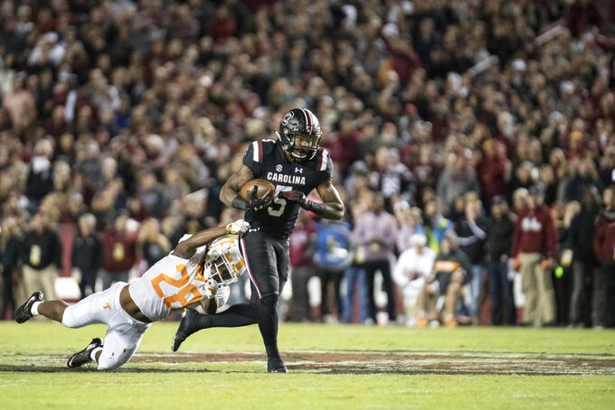 South Carolina running back Rico Dowdle (5) runs with the ball against Tennessee defensive back Baylen Buchanan (28) during the first half of an NCAA college football game Saturday, Oct. 27, 2018, in Columbia, S.C. South Carolina defeated Tennessee 27-24. (AP Photo/Sean Rayford)