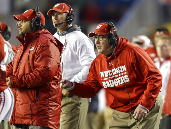 Wisconsin head coach Paul Chryst yells to his players during the second half of an NCAA college football game against Minnesota Saturday, Nov. 24, 2018, in Madison, Wis. Minnesota won 37-15. (AP Photo/Andy Manis)