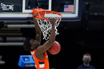 Syracuse's Kadary Richmond dunks during the first half of a second-round game against West Virginia in the NCAA men's college basketball tournament at Bankers Life Fieldhouse, Sunday, March 21, 2021, in Indianapolis. (AP Photo/Darron Cummings)
