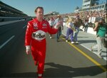 FILE - In this May 20, 1995, file photo, Al Unser Jr. waves after he failed to qualify for the 1995 Indianapolis 500, in Indianapolis, Ind. Chip Ganassi and Michael Andretti have joined Roger Penske in calling for guaranteed spots in the Indianapolis 500. The team owners argue their financial commitment to IndyCar is too steep to afford missing out on the biggest race of the year. (Aaron Wilson/The Albuquerque Journal via AP, File)