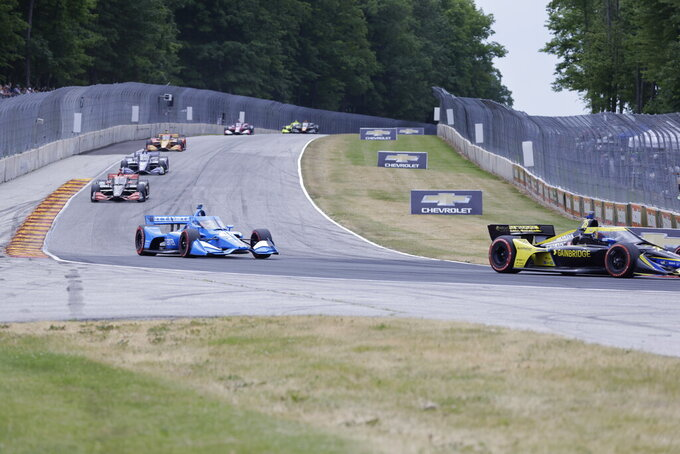 Alex Palou, front left,  competes during an IndyCar race at Road America in Elkhart Lake, Wisc., Sunday, June 20, 2021. (AP Photo/Jeffrey Phelps)