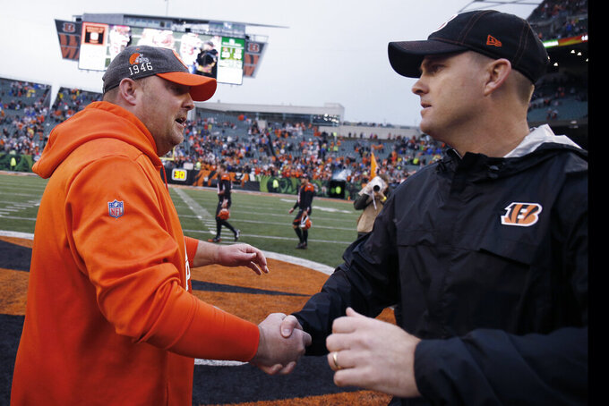 Cleveland Browns head coach Freddie Kitchens, left, congratulates Cincinnati Bengals head coach Zac Taylor after the Bengals defeated the Browns 33-23 in an NFL football game, Sunday, Dec. 29, 2019, in Cincinnati. (AP Photo/Gary Landers)
