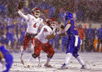 Fresno State quarterback Marcus McMaryion (6) throws the ball as Fresno State offensive lineman Micah St. Andrew (73) blocks Boise State linebacker Curtis Weaver (99) during the first half of an NCAA college football game for the Mountain West championship Saturday, Dec. 1, 2018, in Boise, Idaho. (AP Photo/Steve Conner)