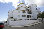 A view of the block of apartments from where British girl Madeleine McCann disappeared in 2007, in Praia da Luz, in Portugal's Algarve coast, Thursday, June 4, 2020. German police said they have identified a suspect -- a 43-year-old German citizen currently imprisoned in his home country for a sexual crime. The suspect spent numerous years in Portugal, including in Praia da Luz around the time of McCann's disappearance. (AP Photo/Armando Franca)