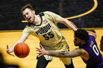 Purdue guard Sasha Stefanovic (55) attempts to save the ball in front of Northwestern guard Boo Buie (0) during the second half of an NCAA college basketball game in West Lafayette, Ind., Saturday, Feb. 6, 2021. (AP Photo/Michael Conroy)