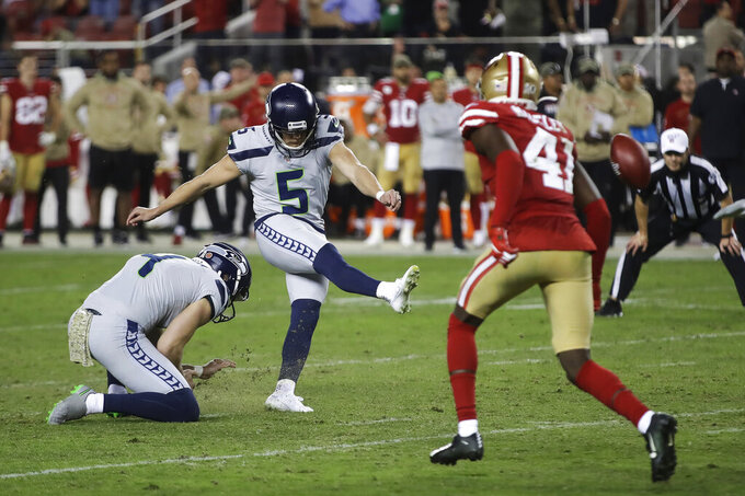 Seattle Seahawks kicker Jason Myers (5) kicks the winning field goal during overtime of an NFL football game against the San Francisco 49ers in Santa Clara, Calif., Monday, Nov. 11, 2019. Seattle won 27-24. (AP Photo/Ben Margot)
