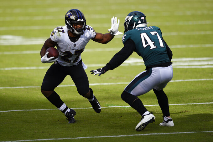 Baltimore Ravens' J.K. Dobbins (27) tries to get past Philadelphia Eagles' Nathan Gerry (47) during the second half of an NFL football game, Sunday, Oct. 18, 2020, in Philadelphia. (AP Photo/Derik Hamilton)