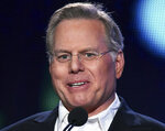 FILE - In this Thursday, Jan. 8, 2015, file photo, David M. Zaslav, President and Chief Executive Officer of Discovery Communications, appears on stage at Discovery Communications 2015 Winter TCA in Pasadena, Calif.  The typical pay package for CEOs at the biggest U.S. companies topped $12.3 million in 2019, and the gap between the boss and their workforces widened further, according to AP's annual survey of executive compensation.   (Photo by Richard Shotwell/Invision/AP, File)