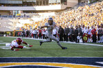 West Virginia wide receiver T.J. Simmons (1) runs for a touchdown after escaping Iowa State defensive back Justin Bickham (7) tackle during the first of an NCAA college football game Saturday, Oct. 12, 2019, in Morgantown, W.Va. (AP Photo/Raymond Thompson)