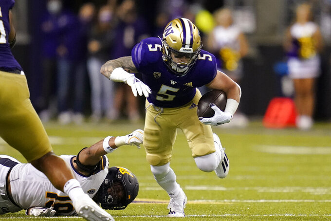 Washington's Sean McGrew (5) carries the ball against California in the second half of an NCAA college football game Saturday, Sept. 25, 2021, in Seattle. (AP Photo/Elaine Thompson)