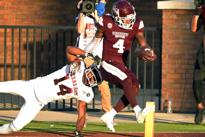 Mississippi State wide receiver Malik Heath (4) skips into the end zone after evading a tackle attempt by Texas A&M defensive back Keldrick Carper (14) during the second half of an NCAA college football game in Starkville, Miss., Saturday, Oct. 17, 2020. (AP Photo/Rogelio V. Solis)