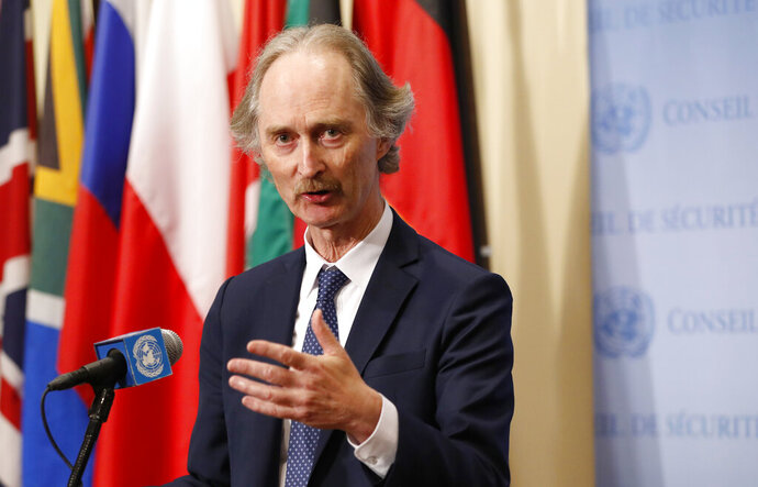 """FILE - In this April 30, 2019 file photo, United Nations Special Envoy for Syria Geir Pedersen gestures as he speaks to the media following a U.N. Security Council meeting on Syria at U.N. headquarter. Pedersen is reporting """"solid progress"""" following talks with officials in the Syrian capital and says they are """"very close to an agreement"""" on establishing a constitutional committee. Geir Pedersen spoke to reporters Wednesday, July 10, 2019, following two meetings with Syrian Foreign Minister Walid Moallem in Damascus. (AP Photo/Kathy Willens, File)"""