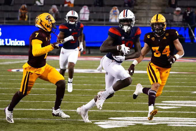 Arizona wide receiver Ma'jon Wright (18) runs for a first down against Arizona State during the first half of an NCAA college football game Friday, Dec. 11, 2020, in Tucson, Ariz. (AP Photo/Rick Scuteri)
