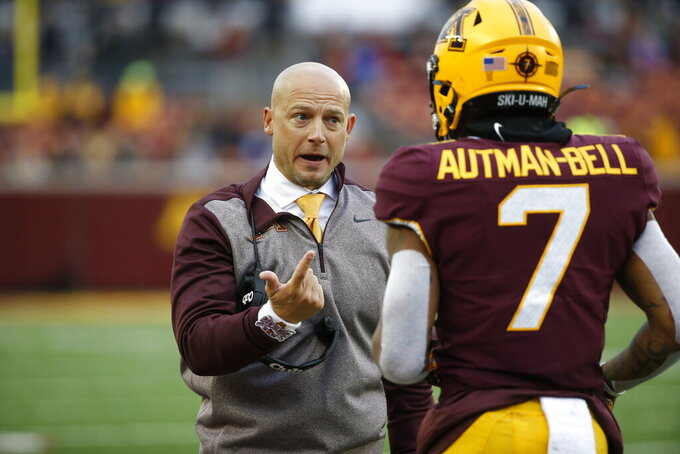 Minnesota head coach P.J. Fleck, left, talks with wide receiver Chris Autman-Bell (7) after a defensive pass interference call on Illinois in the fourth quarter of an NCAA college football game Saturday, Oct. 5, 2019, in Minneapolis. (AP Photo/Bruce Kluckhohn)