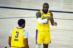 Los Angeles Lakers'  Anthony Davis (3) with LeBron James (23) during the first half of an NBA basketball game against the Oklahoma City Thunder Wednesday, Aug. 5, 2020, in Lake Buena Vista, Fla. (Kevin C. Cox/Pool Photo via AP)