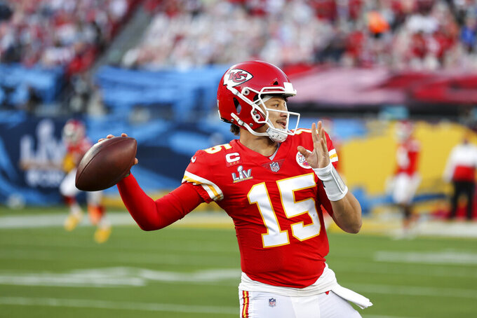 Kansas City Chiefs quarterback Patrick Mahomes (15) throws the ball in warmups prior to the NFL Super Bowl 55 football game against the Tampa Bay Buccaneers, Sunday, Feb. 7, 2021, in Tampa, Fla. (Ben Liebenberg via AP)