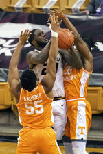 Missouri's Jeremiah Tilmon, center, tries to shoot between Tennessee's E.J. Anosike, left, and Yves Pons, right, during the first half of an NCAA college basketball game Wednesday, Dec. 30, 2020, in Columbia, Mo. (AP Photo/L.G. Patterson)