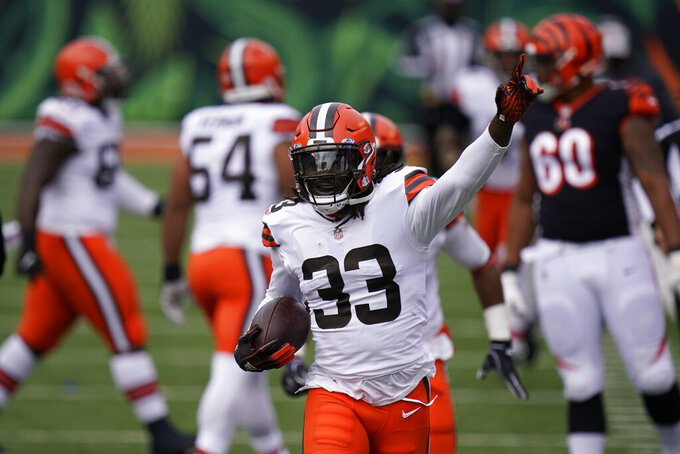 Cleveland Browns' Ronnie Harrison (33) celebrates a fumble recovery during the first half of an NFL football game against the Cincinnati Bengals, Sunday, Oct. 25, 2020, in Cincinnati. (AP Photo/Bryan Woolston)