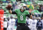 Marshall quarterback Grant Wells makes a throw during an NCAA college football game against Rice on Saturday, Dec. 5, 2020, in Huntington, W.Va.  (Sholten Singer/The Herald-Dispatch via AP)