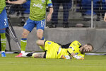 Seattle Sounders goalkeeper Stefan Frei (24) grimaces after colliding with a San Jose Earthquakes player during the second half of an MLS soccer match Wednesday, May 12, 2021, in San Jose, Calif. The Sounders won 1-0. (AP Photo/Tony Avelar)