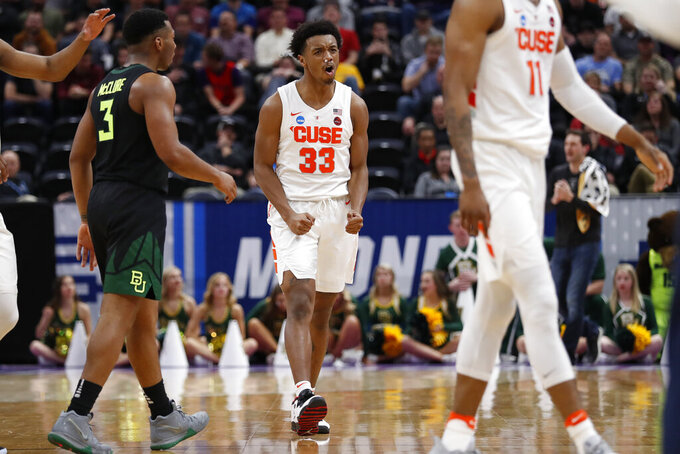 Syracuse forward Elijah Hughes (33) reacts near Baylor guard King McClure (3) during the second half of a first-round game in the NCAA men's college basketball tournament Thursday, March 21, 2019, in Salt Lake City. (AP Photo/Jeff Swinger)