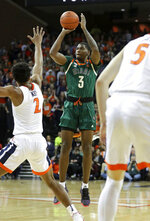 Miami guard Anthony Lawrence II (3) shoots over Miami guard Willie Herenton (2) during an NCAA college basketball game Saturday, Feb. 2, 2019, in Charlottesville, Va. (AP Photo/Andrew Shurtleff)