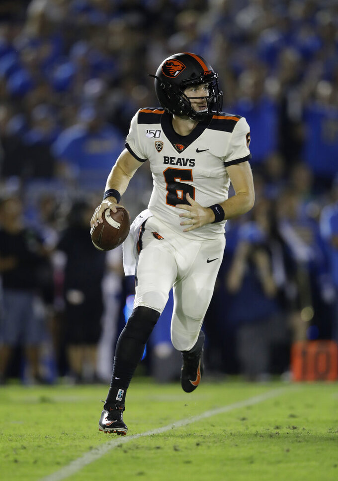 Oregon State quarterback Jake Luton rolls out against UCLA during the first half of an NCAA college football game Saturday, Oct. 5, 2019, in Pasadena, Calif. (AP Photo/Marcio Jose Sanchez)