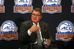 Atlantic Coast Conference commissioner John Swofford listens to a question at a press conference during the ACC NCAA college basketball media day in Charlotte, N.C., Tuesday, Oct. 8, 2019. (AP Photo/Nell Redmond)