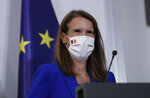 Belgian Prime Minister Sophie Wilmes, wearing a protective mask, prepares to address a press conference following the National Security Council meeting on the COVID-19 outbreak, in Brussels, Wednesday, Sept. 23, 2020. Belgium's prime minister announced Wednesday a relaxation of social-distancing rules as part of a less stringent long-term coronavirus strategy, despite the steady rise of COVID-19 cases in a country already hard-hit by the virus. (Olivier Hoslet, Pool via AP)