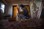"Kashmiri artist Tabish Haider paints inside his house in Srinagar, Indian controlled Kashmir, July 22, 2020. A year after India ended disputed Kashmir's semi-autonomous status and downgraded it to a federally governed territory, authorities have begun issuing residency and land ownership rights to outsiders for the first time in almost a century. Many Kashmiris like Haider view the move as the beginning of settler colonialism aimed at engineering a demographic change in India's only Muslim-majority region. ""They have recently introduced a law which is a domicile law, which basically says that we as Kashmiris, who have been living here for past many generations, they have to prove their own identity in their own land. So how can a piece of paper prove my identity in my own land? Haider asked. (AP Photo/Mukhtar Khan)"