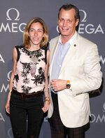 FILE- In this June 10, 2014, file photo, Nicole Mellon, left, and Matthew Mellon, right, attend the Omega Speedmaster Dark Side of the Moon launch event in New York. Billionaire banking heir Matthew Mellon has died. His cousin Peter Stephaich confirmed Mellon's death but declined Tuesday, April 17, 2018, to provide any details. He was 54. (Photo by Andy Kropa/Invision/AP, File)