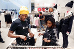 Houston Texans' De'Andre Hopkins, left, helps Miracle Washington-Tribble, right, pick out clothes at H&M on Monday, Dec. 16, 2019, at Galleria Mall in Houston. Washington-Tribble is one of two teens who benefitted from Eight Million Stories, a Houston program which helps 14-18-year-olds who have either quit or been kicked out of school continue their education, find employment and receive emotional support. (AP Photo/Michael Wyke)