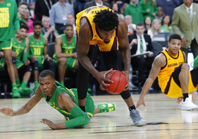 Oregon's Louis King, left, and Arizona State's Romello White scramble for the ball during the second half of an NCAA college basketball game in the semifinals of the Pac-12 men's tournament Friday, March 15, 2019, in Las Vegas. (AP Photo/John Locher)