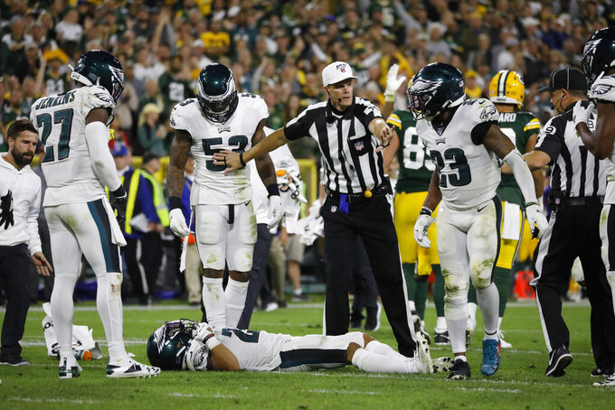 Philadelphia Eagles cornerback Avonte Maddox lies injured on the field during the second half of the team's NFL football game against the Green Bay Packers on Thursday, Sept. 26, 2019, in Green Bay, Wis. Philadelphia won 34-27. (AP Photo/Jeffrey Phelps)