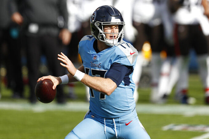 Tennessee Titans quarterback Ryan Tannehill scrambles against the Cleveland Browns in the first half of an NFL football game Sunday, Dec. 6, 2020, in Nashville, Tenn. (AP Photo/Wade Payne)