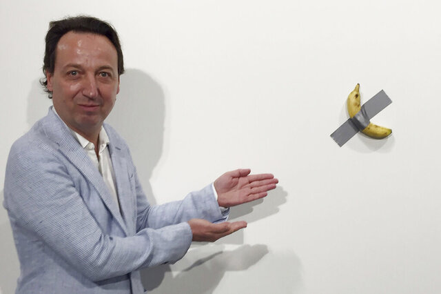 FILE- In this Dec. 4, 2019 photo, gallery owner Emmanuel Perrotin poses next to Italian artist Maurizio Cattlelan's