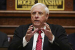 FILE - In this Jan. 8, 2020, file photo, West Virginia Gov. Jim Justice delivers his annual State of the State address in the House Chambers at the state capitol in Charleston, W.Va. Justice said Thursday, July 2, 2020, that residents should prepare for a mandatory face mask order as the state's new coronavirus cases rise to their highest level since the pandemic began. (AP Photo/Chris Jackson, File)