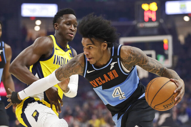 FILE - Cleveland Cavaliers' Kevin Porter Jr., right, drives past Indiana Pacers' Victor Oladipo in the first half of an NBA basketball game in Cleveland, in this Saturday, Feb. 29, 2020, file photo. Kevin Porter quickly went from being a future star with the Cavaliers to part of their past. Cleveland finalized its trade with Houston on Friday, Jan. 22, 2021, sending Porter to the Rockets for a future second-round draft pick. (AP Photo/Tony Dejak)
